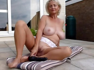 Mature lady is playing with her wet pussy