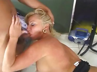 Mature blonde giving head